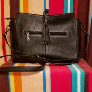 Shoulder / cross body bag with adjustable strap.